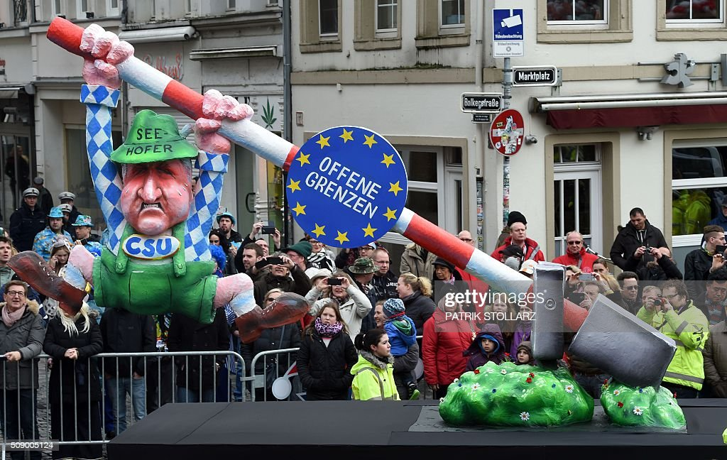 A carnival float, depicting Bavaria's State Premier Horst Seehofer who tries to close the border, stands in front of the city hall in Duesseldorf, western Germany, after the Rose Monday (Rosenmontag) street parade has been cancelled on February 8, 2016. Traditional Rose Monday carnival parades in several western German cities have been cancelled due to stormy weather. / AFP / PATRIK STOLLARZ
