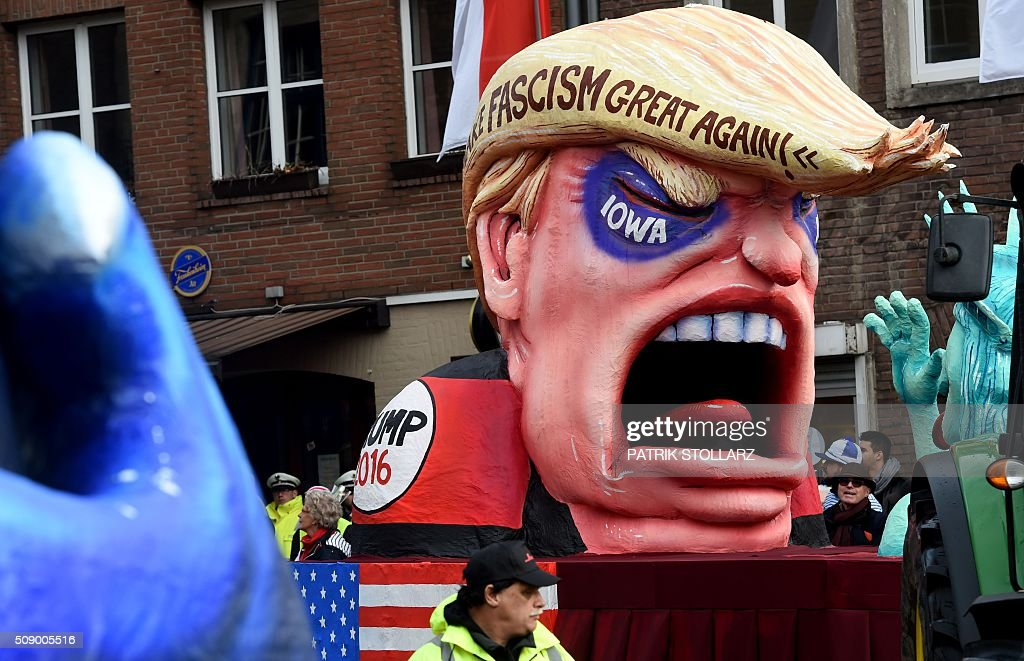 A carnival float depicting Republican presidential candidate Donald Trump is parked in front of the city hall in Duesseldorf, western Germany, after the Rose Monday (Rosenmontag) street parade has been cancelled on February 8, 2016. Traditional Rose Monday carnival parades in several western German cities have been cancelled due to stormy weather. / AFP / PATRIK STOLLARZ