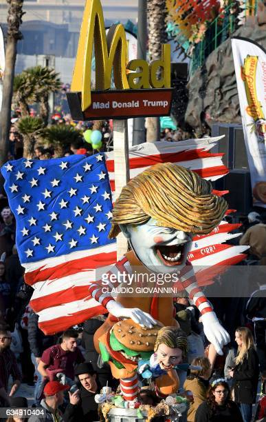 A carnival float entitled 'Mad Donald Trump' depicting US President Donald Trump and former US democratic presidential candidate Hillary Clinton...