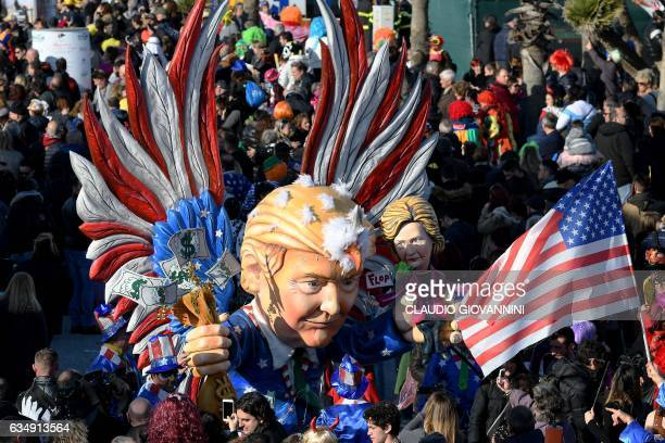A carnival float entitled 'The harebrained Trump ' rolls through the streets of Viareggio during the traditional carnival in Tuscany on February 12...