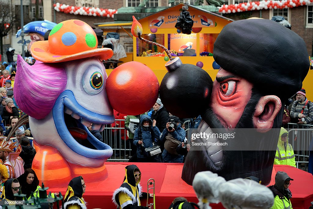 A carnival float featuring a clown facing an Islamic fighter stands on display near city hall on February 8, 2016 in Duesseldorf, Germany. Today's Rose Monday parade, the highlight of western Germany's carnival season, has been cancelled due to weather predictions that include high winds.