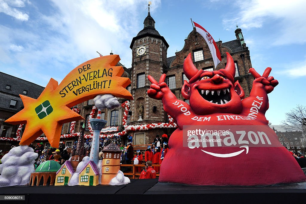 A carnival float featuring a red devil reading 'Death of Retail - Amazon' stands on display near city hall on February 8, 2016 in Duesseldorf, Germany. Today's Rose Monday parade, the highlight of western Germany's carnival season, has been cancelled due to weather predictions that include high winds.