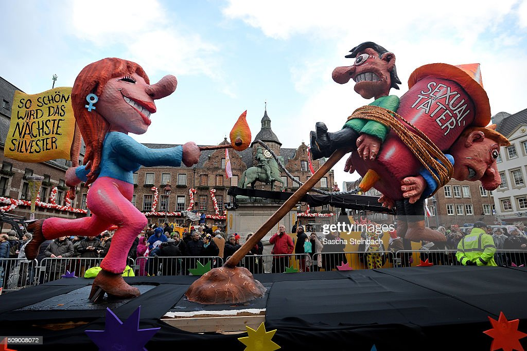 A carnival float featuring a woman lighting up a rocket with two men chained on it alluding to the sexual assaults in New Year's Eve stands on display near city hall on February 8, 2016 in Duesseldorf, Germany. Today's Rose Monday parade, the highlight of western Germany's carnival season, has been cancelled due to weather predictions that include high winds.