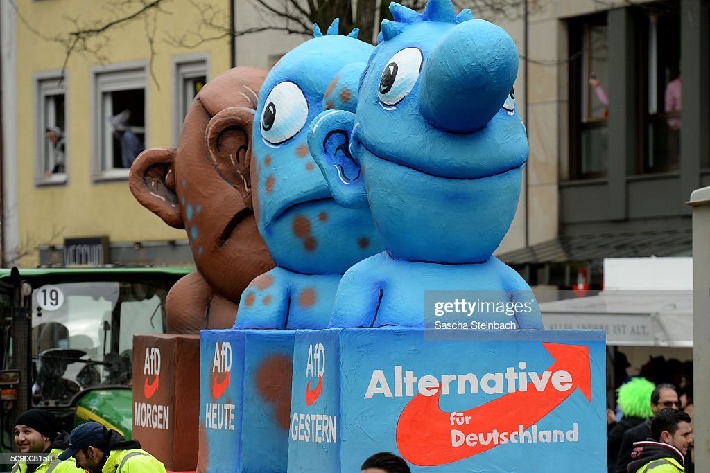 A carnival float featuring Germany's AfD party metamorphosing from a blue to a brown character stands on display near city hall on February 8, 2016 in Duesseldorf, Germany. Today's Rose Monday parade, the highlight of western Germany's carnival season, has been cancelled due to weather predictions that include high winds.