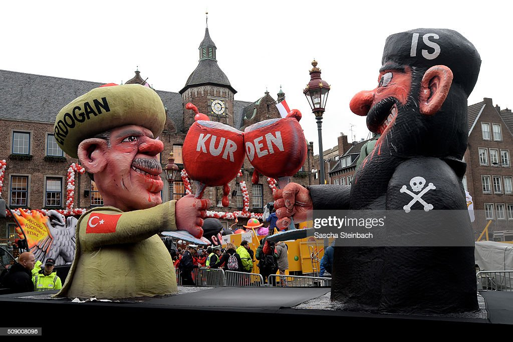 A carnival float featuring Turkish President <a gi-track='captionPersonalityLinkClicked' href=/galleries/search?phrase=Recep+Tayyip+Erdogan&family=editorial&specificpeople=213890 ng-click='$event.stopPropagation()'>Recep Tayyip Erdogan</a> clinking his glass with a fighter of the Islamic State (IS) stands on display near city hall on February 8, 2016 in Duesseldorf, Germany. Today's Rose Monday parade, the highlight of western Germany's carnival season, has been cancelled due to weather predictions that include high winds.