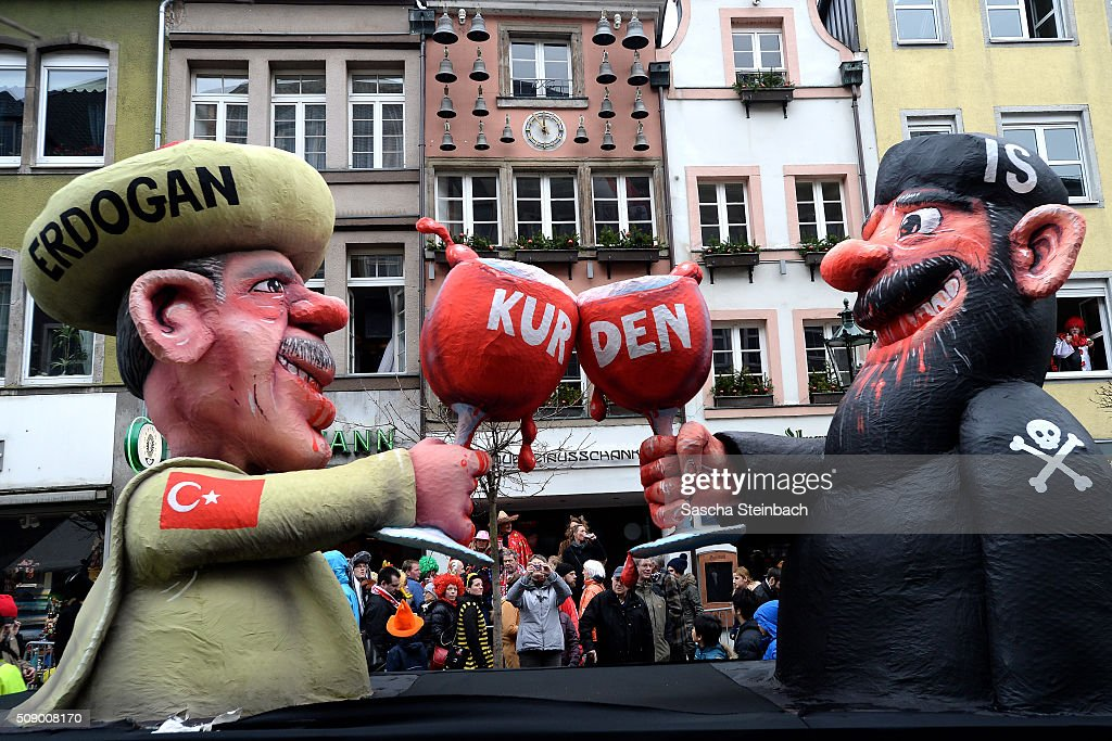 A carnival float featuring Turkish President Recep Tayyip Erdogan toasting his glass with a fighter of the Islamic State (IS) stands on display near city hall on February 8, 2016 in Duesseldorf, Germany. Today's Rose Monday parade, the highlight of western Germany's carnival season, has been cancelled due to weather predictions that include high winds.