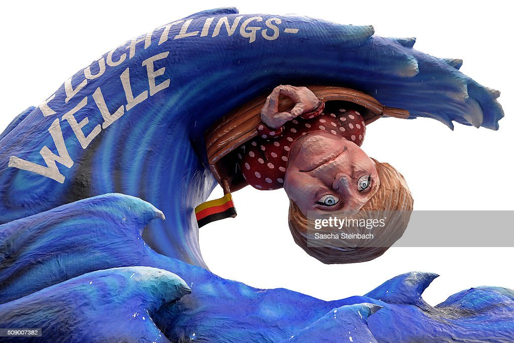 A carnival float mocking German Chancellor Angela Merkel stands on display near city hall on February 8, 2016 in Duesseldorf, Germany. Today's Rose Monday parade, the highlight of western Germany's carnival season, has been cancelled due to weather predictions that include high winds.
