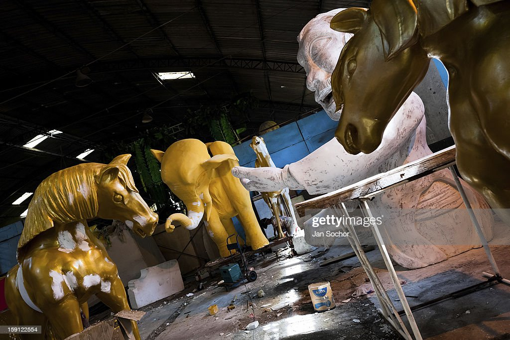 Carnival float sculptures of Império Serrano samba school seen during the modeling process inside the workshop in Rio de Janeiro, Brazil, 15 February 2012. The carnival preparations start early in July or August, some 7-8 months before the main samba schools parade at the sambodrome. Samba schools hire teams of professional designers and artists who, according to the original theme selected by the school directors and then featured by the school during the parade, create allegorical floats, costumes, sculptures, music, choreography and the entire school show. However, the most of the everyday work in the carnival hangars is performed by unknown but fully dedicated samba schools members.