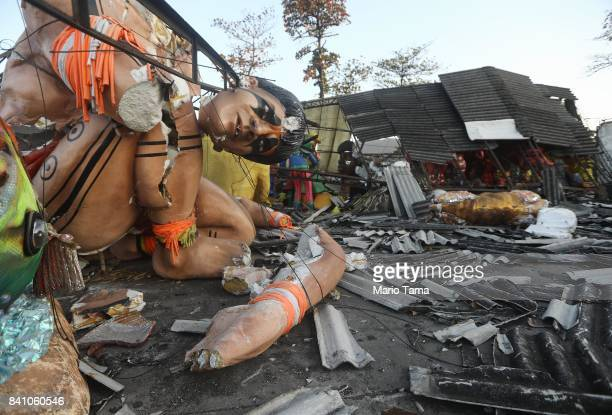 Carnival float sculptures rest amidst the rubble of the Carnival floats warehouse for the Renascer de Jacarepagua samba school on August 29 2017 in...