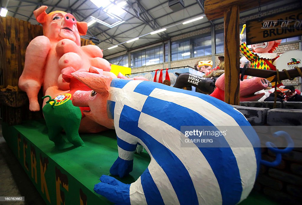 A carnival float shows German Chancellor Angela Merkel as a sow and piglets painted with the flags of Greece and Portugal during a presentation of this year's canival floats of the carnival's comittee inCologne, westernGermany, on February 5, 2013.