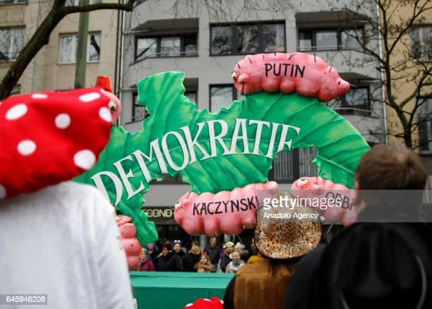 A carnival float with a papiermache caricature of worms with the names of Vladimir Putin Jaroslav Kaczynski and Victor Orban eating on a leaf is seen...