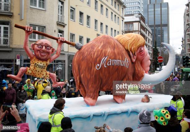 A carnival float with a papiermache caricatures of Germany SPD party's Martin Schult with opponent German Chancellor Angela Merkel is seen during the...