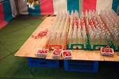 Carnival game with bottles and rings