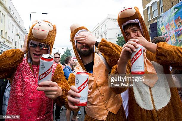 Carnival goers dressed as monkeys enjoy a Red Stripe lager at the Notting Hill Carnival on August 24 2014 in London England