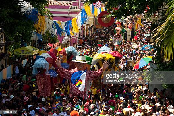 Carnival goers follow the Giant Puppets parade on February 24 2009 in Olinda Brazil