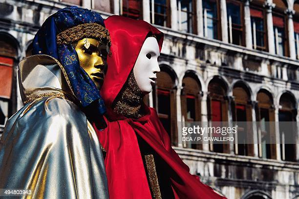 Carnival mask in St Mark's square Venice Italy