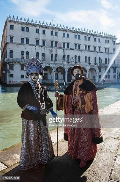 Carnival mask in Venice on Canal Grande