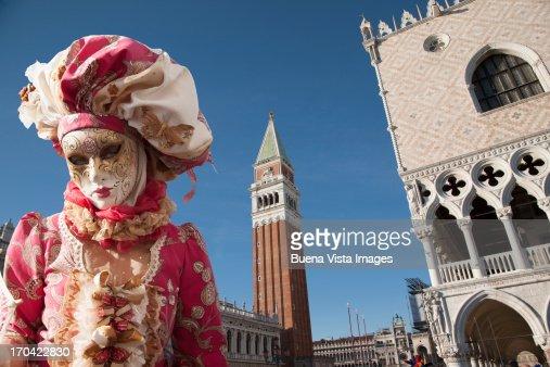 Carnival mask in Venice posing in San Marco square