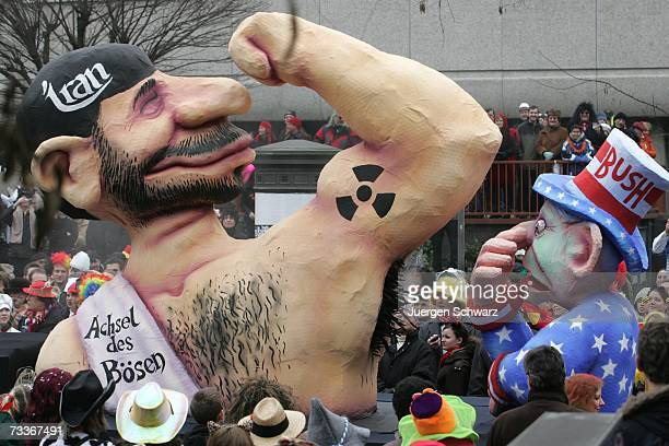 A carnival parade float features graphic caricature models representing US President George W Bush sniffing the armpit of Iranian President Mahmoud...
