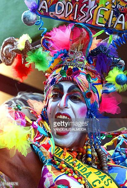 Carnival participant dances the Samba during the traditional parade of the Carmen Miranda Carnival Band in Rio de Janeiro Brazil 18 February 2001 The...