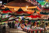 Amusement arcade at a traveling carnival.