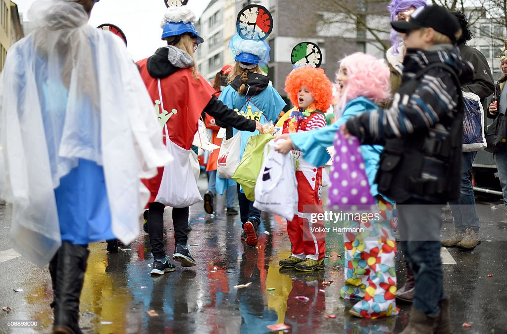 Carnival reveller celebrate during a carnival parade called 'Schull- un Veedelszoech' as part of the carnival season on February 7, 2016 in Cologne, Germany. Carnival partying and parades, a centuries-old tradition in western and southwestern Germany, traditionally occurs in February and runs until Ash Wednesday, the start of Lent, and culminates in Rose Monday parades and festivities. Police are on added alert this year, particularly in Cologne, due to the New Year`s Eve sex attacks on women that have been attributed to gangs of North African men, predominantly from Algeria and Morocco.