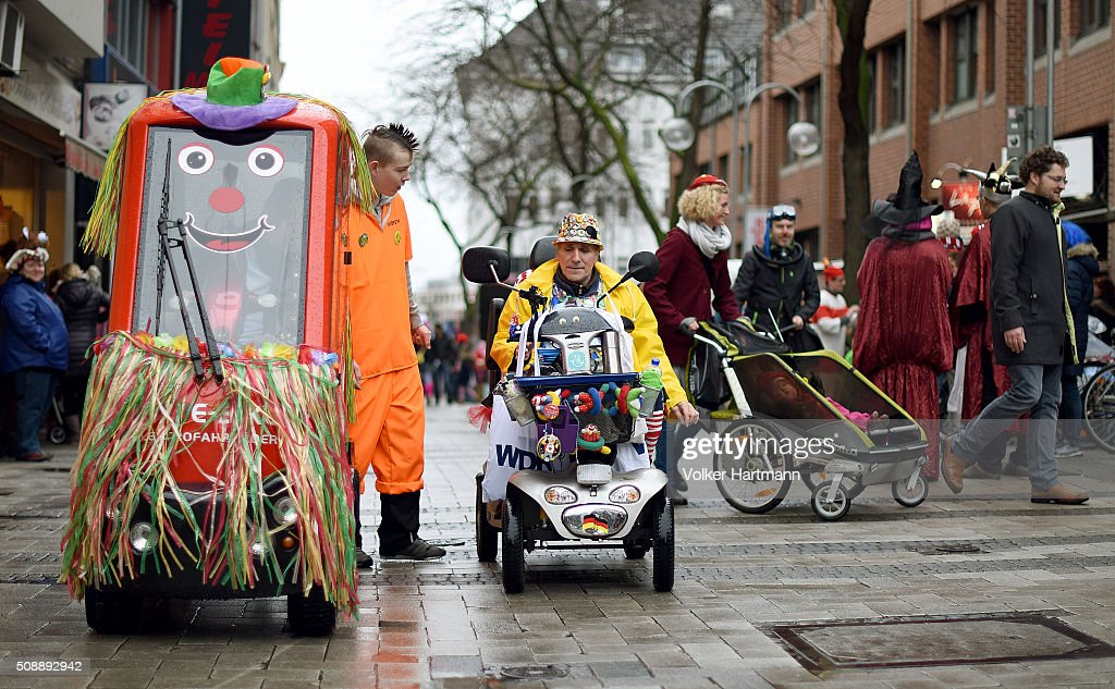 A Carnival reveller drives in an electric wheel chair during a carnival parade called 'Schull- un Veedelszoech' as part of the carnival season on February 7, 2016 in Cologne, Germany. Carnival partying and parades, a centuries-old tradition in western and southwestern Germany, traditionally occurs in February and runs until Ash Wednesday, the start of Lent, and culminates in Rose Monday parades and festivities. Police are on added alert this year, particularly in Cologne, due to the New Year`s Eve sex attacks on women that have been attributed to gangs of North African men, predominantly from Algeria and Morocco.