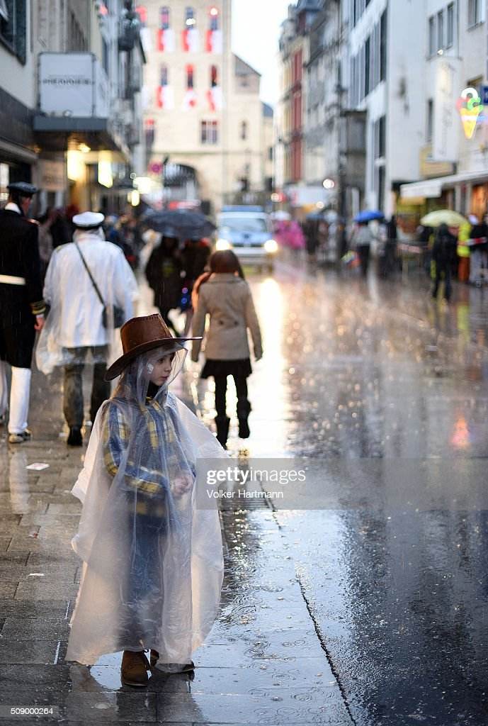 Carnival revellers attend the annual Rose Monday parade in hard rain on February 8, 2016 in Cologne, Germany. The centuries-old tradition of German carnival occurs in February and runs until Ash Wednesday, the start of Lent, and culminates in Rose Monday celebrations. Police are on added alert this year, particularly in Cologne, due to the New Year`s Eve sex attacks on women that have been attributed to gangs of migrants.