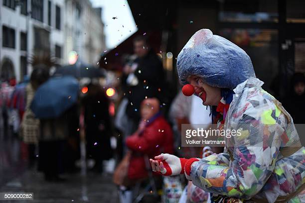 Carnival revellers attend the annual Rose Monday parade in hard rain on February 8 2016 in Cologne Germany The centuriesold tradition of German...