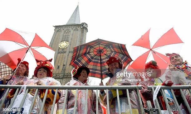 Carnival revellers celebrate in the rain during the annual Rose Monday parade on February 8 2016 in Cologne Germany The centuriesold tradition of...