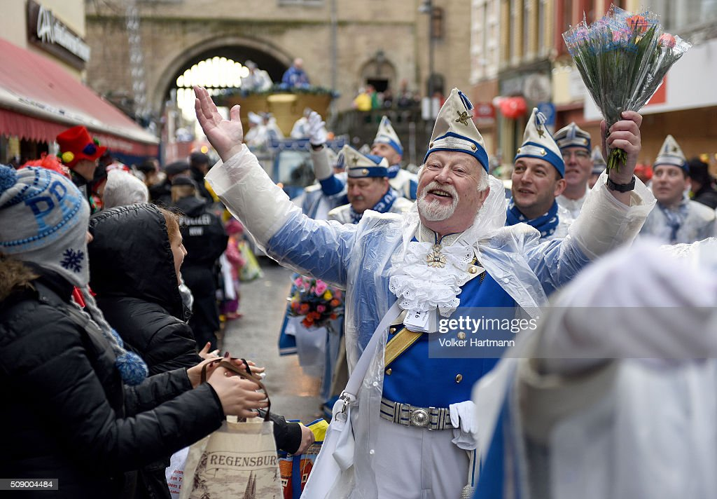 Carnival revellers celebrate in the rain during the annual Rose Monday parade on February 8, 2016 in Cologne, Germany. The centuries-old tradition of German carnival occurs in February and runs until Ash Wednesday, the start of Lent, and culminates in Rose Monday celebrations. Police are on added alert this year, particularly in Cologne, due to the New Year`s Eve sex attacks on women that have been attributed to gangs of migrants.