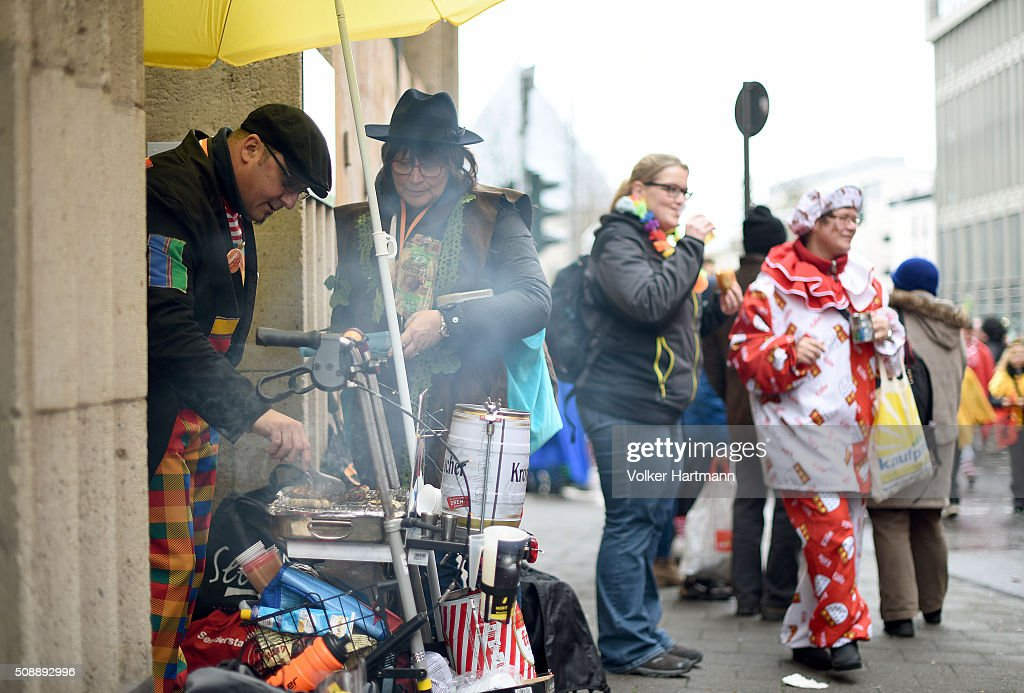 A Carnival revellers hide underneath a blind during a carnival parade called 'Schull- un Veedelszoech' as part of the carnival season on February 7, 2016 in Cologne, Germany. Carnival partying and parades, a centuries-old tradition in western and southwestern Germany, traditionally occurs in February and runs until Ash Wednesday, the start of Lent, and culminates in Rose Monday parades and festivities. Police are on added alert this year, particularly in Cologne, due to the New Year`s Eve sex attacks on women that have been attributed to gangs of North African men, predominantly from Algeria and Morocco.