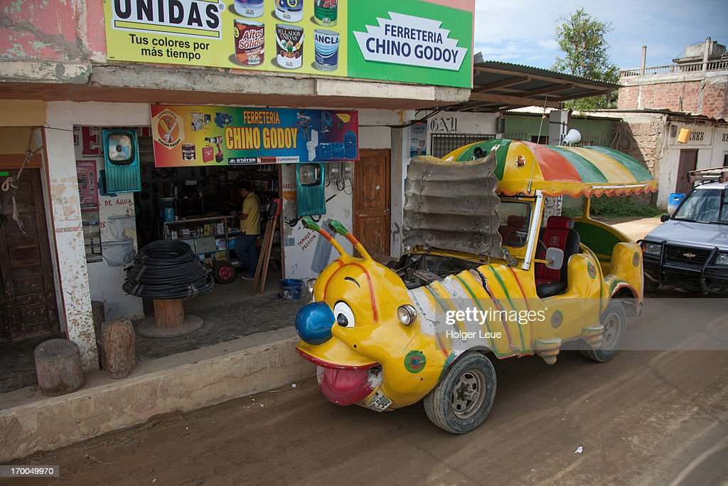 Carnival ride car in front of repair shop : Stock Photo