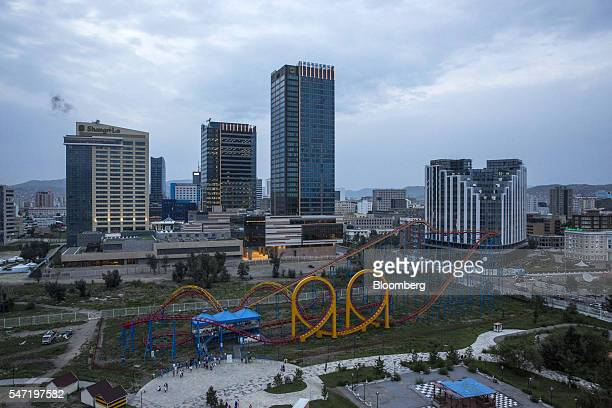 Carnival rides at the National Amusement Park known as the Children's Park stand in front of commercial buildings in Ulaanbaatar Mongolia on...