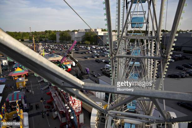 Carnival rides sit in the parking lot of the Marley Station Mall during the Dreamland Amusements carnival in Glen Burnie Maryland US on Friday April...