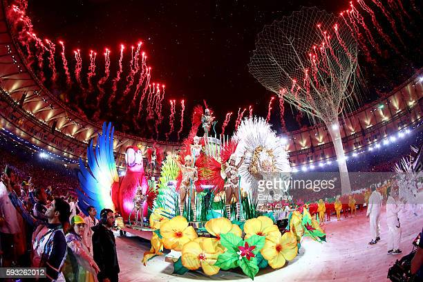 Carnival singers and dancers perform as fireworks explode near the conclusion of the Closing Ceremony on Day 16 of the Rio 2016 Olympic Games at...
