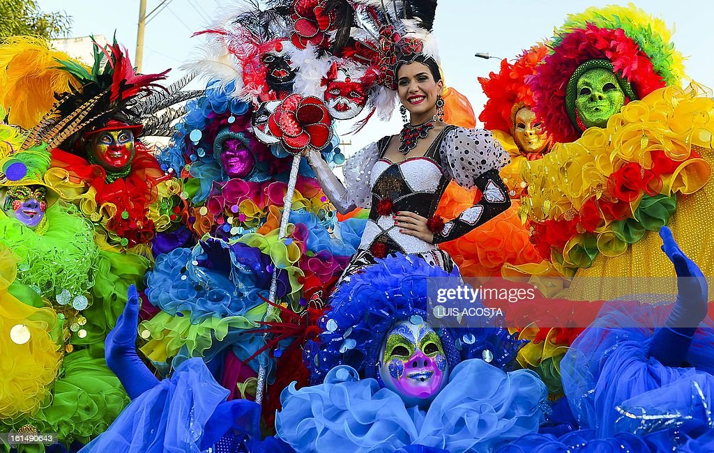 Carnival's Queen Daniela Cepeda (C) poses with dancers during the third day of carnival in Barranquilla, Colombia, on February 11, 2013. Barranquilla's Carnival, a tradition created by locals at the end of the 19th century as a response and to parody the celebration held by European immigrants and aristocracy, was declared a 'Masterpiece of Oral and Intangible Heritage of Humanity' by the UNESCO in 2003. AFP PHOTO/Luis Acosta