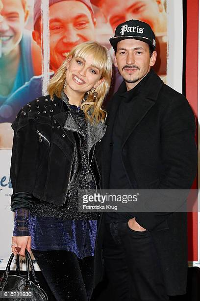 Caro Cult and Arnel Taci attend the German premiere of the film 'Nirgendwo' at Cubix Alexanderplatz on October 17 2016 in Berlin Germany