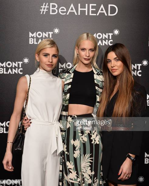 Caro Dauer Poppy Delevingne and Negin Misalehi attend the Montblanc Summit launch event at The Ledenhall Building on March 16 2017 in London England