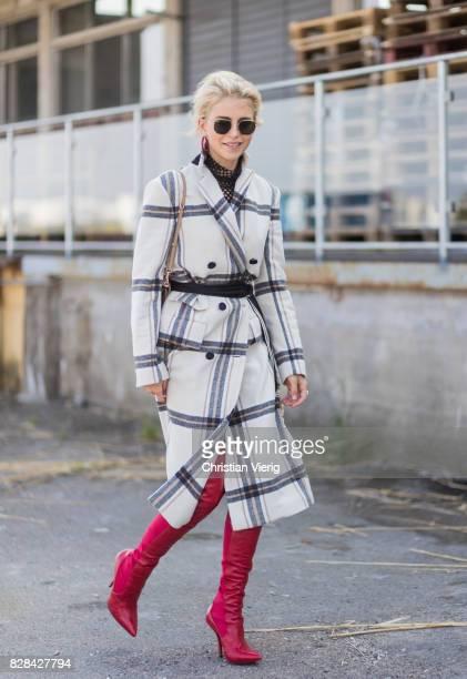 Caro Daur wearing a plaid coat By Malene Birger Dolce Gabbana bag red boots outside By Malene Birger on August 09 2017 in Copenhagen Denmark