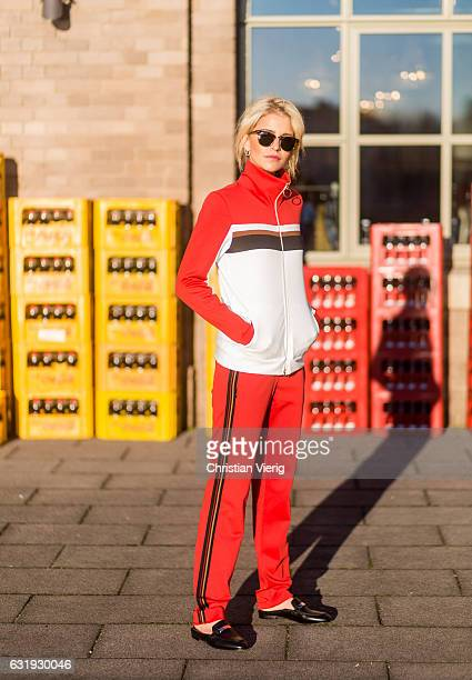Caro Daur wearing a red track suit and Marc Cain loafers during the MercedesBenz Fashion Week Berlin A/W 2017 on January 17 2017 in Berlin Germany