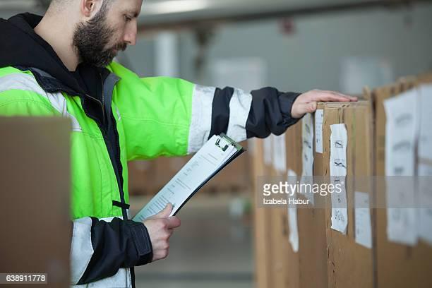 Caro men checking parcels
