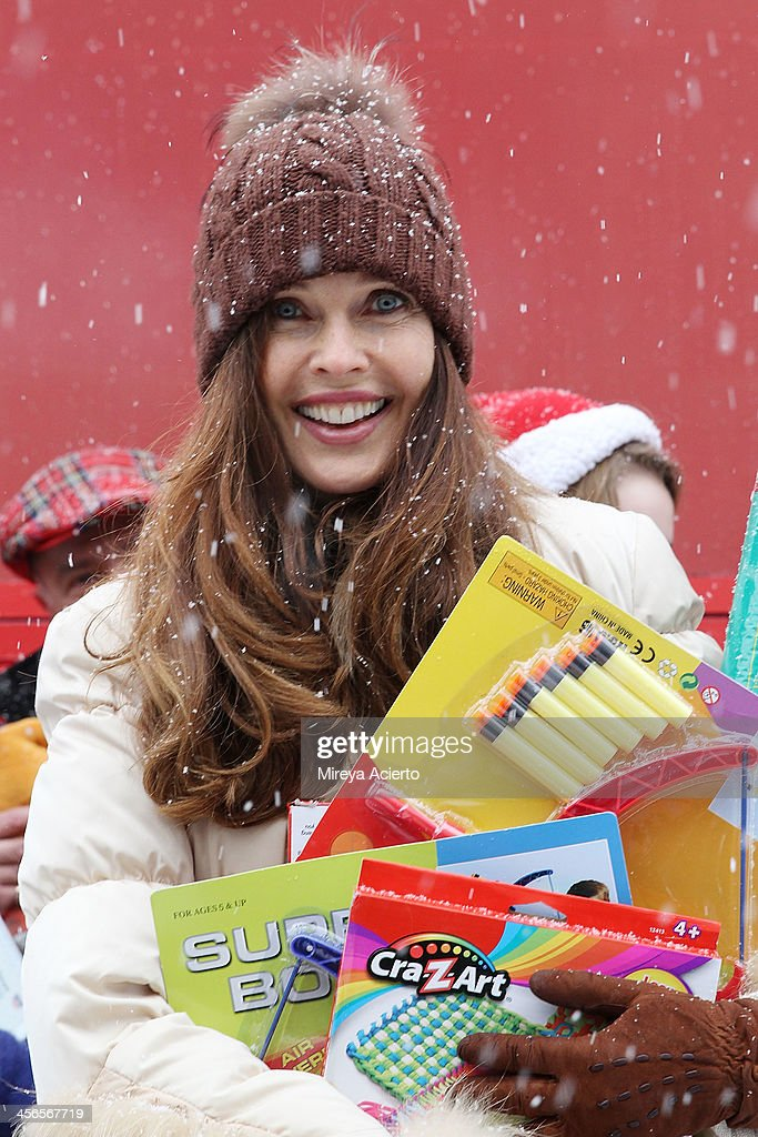 Carol Alt attends CitySightseeing New York 2013 holiday toy drive at PAL's Harlem Center on December 14, 2013 in New York City.
