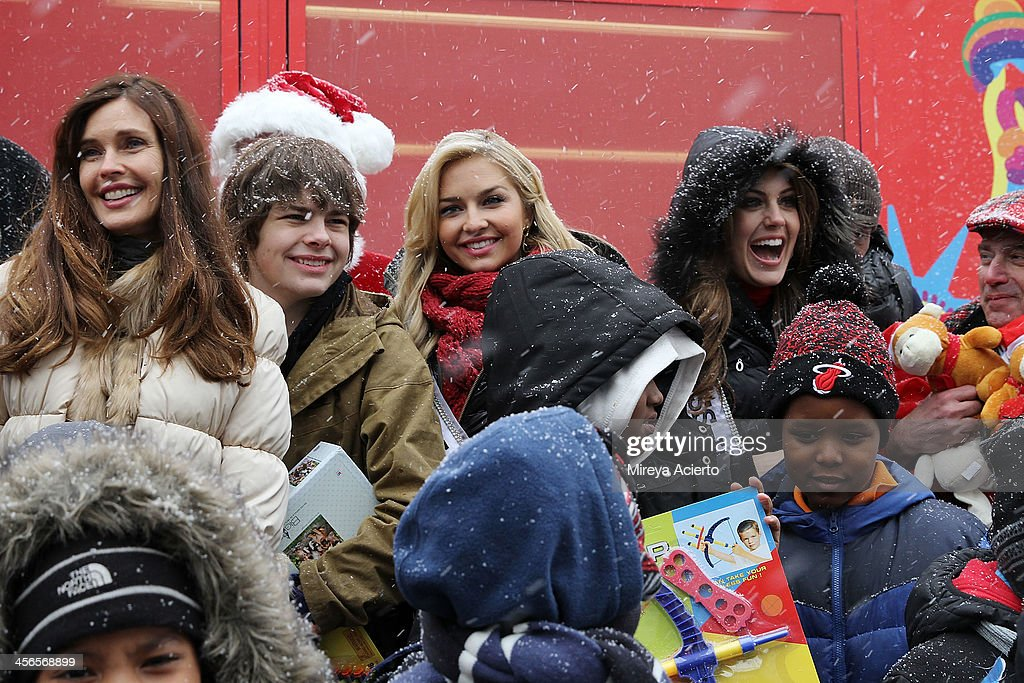 Carol Alt, Brendan Meyer, Cassidy Wolf and Erin Brady attend CitySightseeing New York 2013 holiday toy drive at PAL's Harlem Center on December 14, 2013 in New York City.