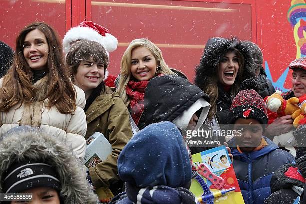 Carol Alt Brendan Meyer Cassidy Wolf and Erin Brady attend CitySightseeing New York 2013 holiday toy drive at PAL's Harlem Center on December 14 2013...