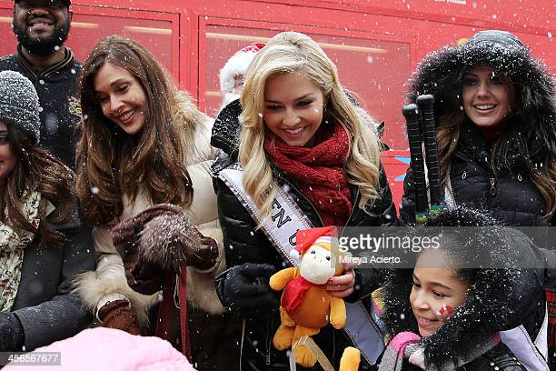 Carol Alt Cassidy Wolf and Erin Brady attend CitySightseeing New York 2013 holiday toy drive at PAL's Harlem Center on December 14 2013 in New York...