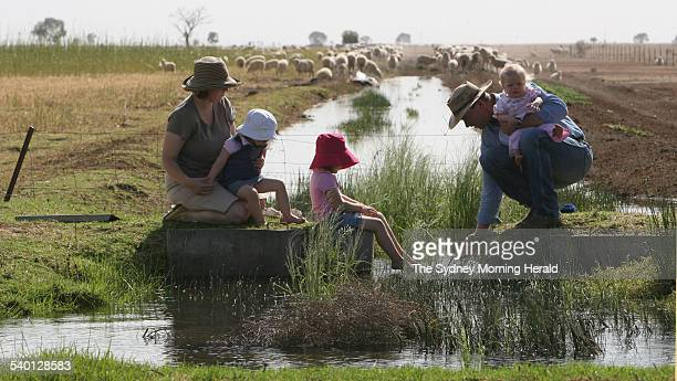 Carol and Stephen Huggins with their children Isobel wearing red hat Lily wearing white hat and Olivia eleven months old on their recently bought...