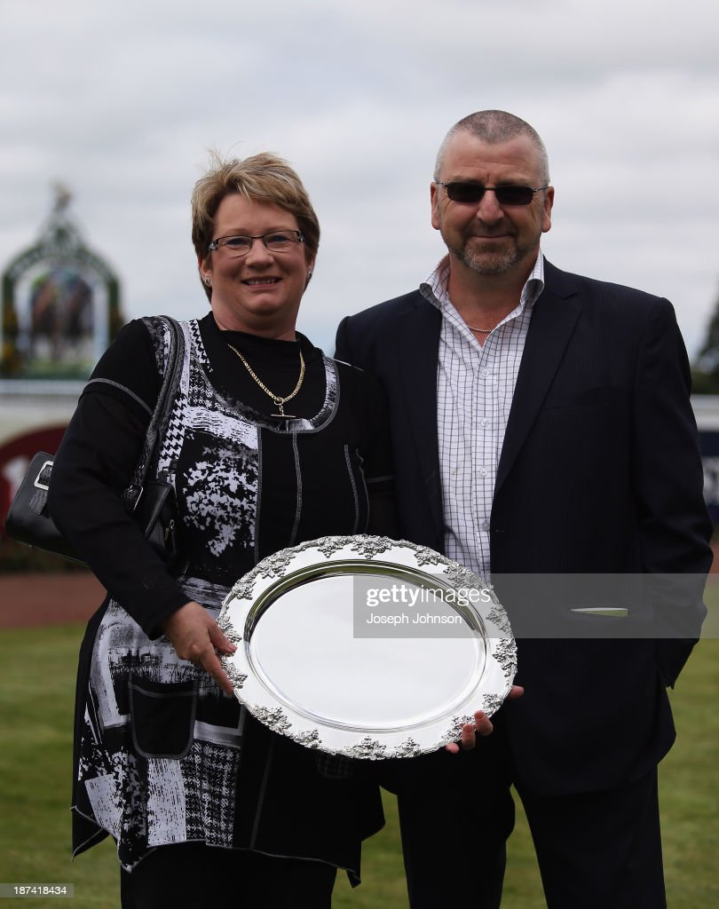 Carol and Tony Rennell representing the Pak'n'Save syndicate pose with the trophy after Irish Fling with jockey Mark Du Plessis won the Yesberg Insurance Services Pegasus Stakes during New Zealand 2000 Guineas Day on November 9, 2013 in Christchurch, New Zealand.