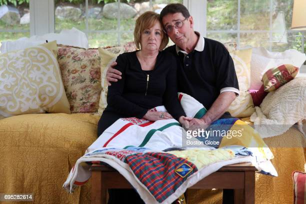 Carol and Warren Chesley pose for a portrait with a memory quilt honoring their son Jason at their home in Wakefield MA on May 12 2017 Their son...
