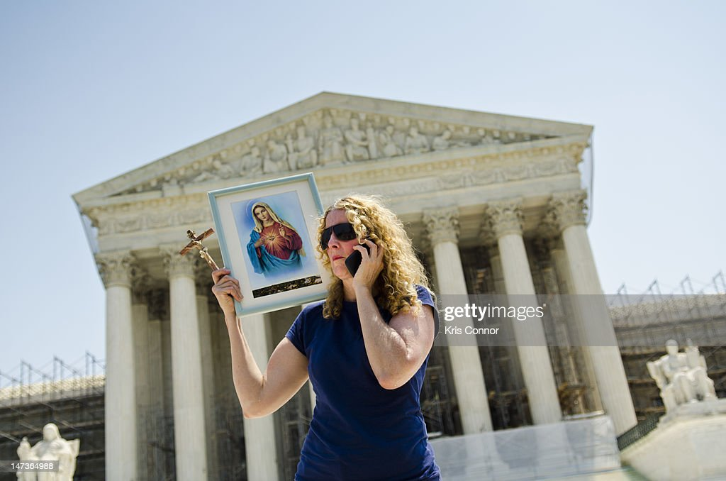 Carol Anderson protests outside the U.S. Supreme Court on June 28, 2012 in Washington, DC. The Court found the Affordable Healthcare Act to be constitutional and did not strike down any part of it.